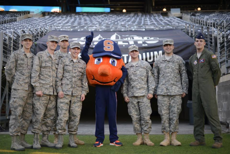 ROTC students pose with Otto the Orange