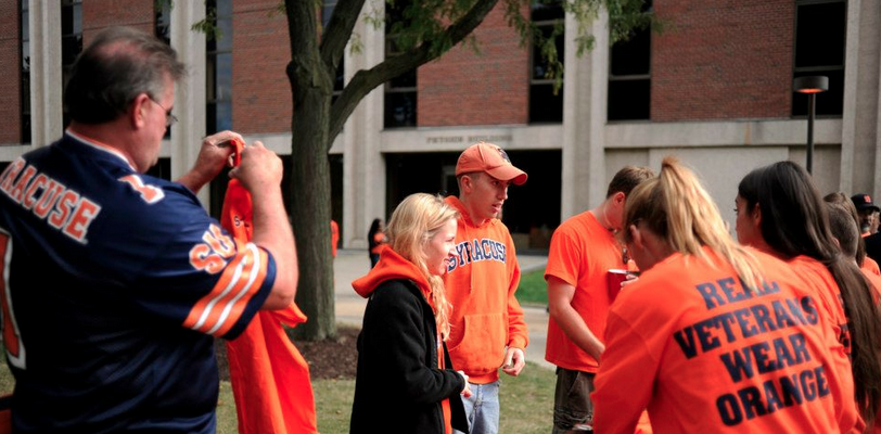 Students passing out Real Veterans Wear Orange shirts