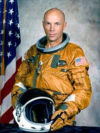 Dr. Franklin Story Musgrave in NASA spacesuit