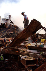 fireman standing on wreckage of 9/11