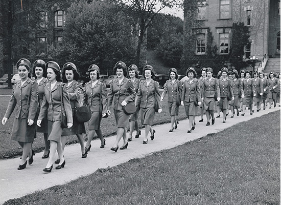 cadet nurses walking through quad