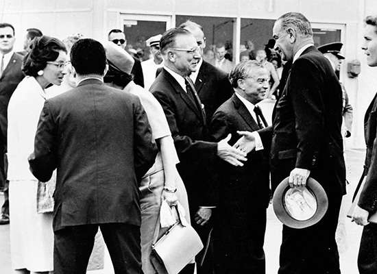Chancellor Tolley shaking hands with President Johnson at Hancock International Airport