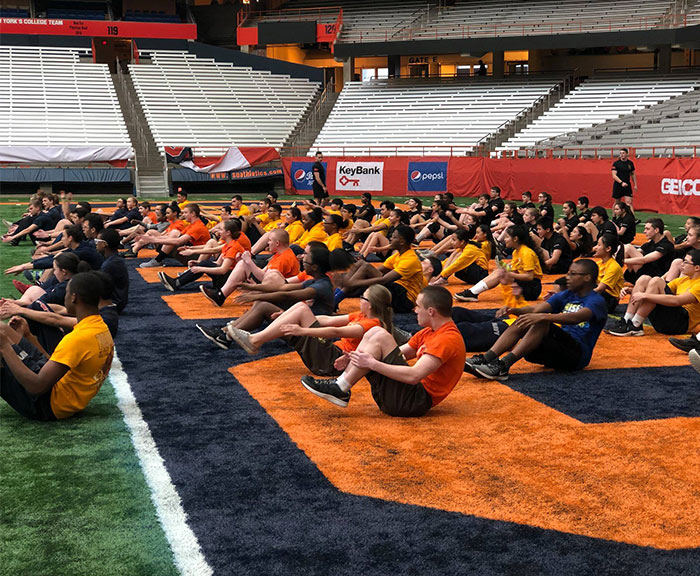 High school jr ROTC students doing sit-ups in the dome for the ROTc Fitness Challenge.