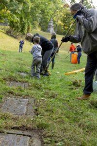 Raking leaves at Oakwood Cemetery.