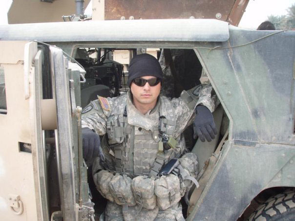 Jay Knight near Humvee in uniform