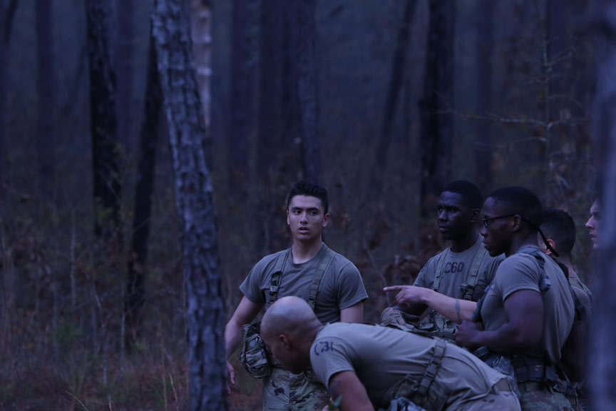 ROTC Cadets catching their breath in forest.
