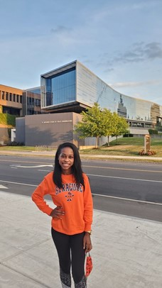 Darasha standing in front of Newhouse.