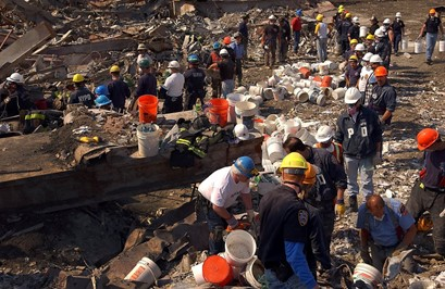Rescuers with hundreds of buckets.
