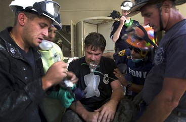 Firemen giving oxygen