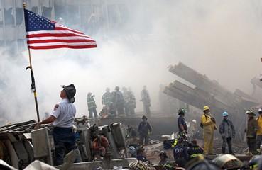 Fireman saluting american flag