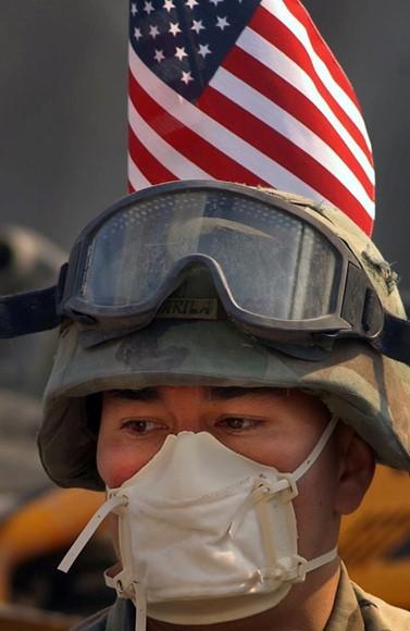 Fireman with mask and flag