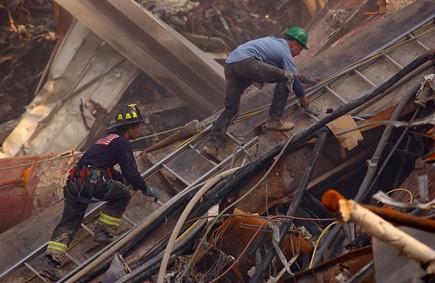 Firemen climbing ladder